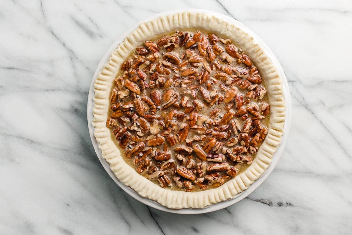 An unbaked pecan pie.