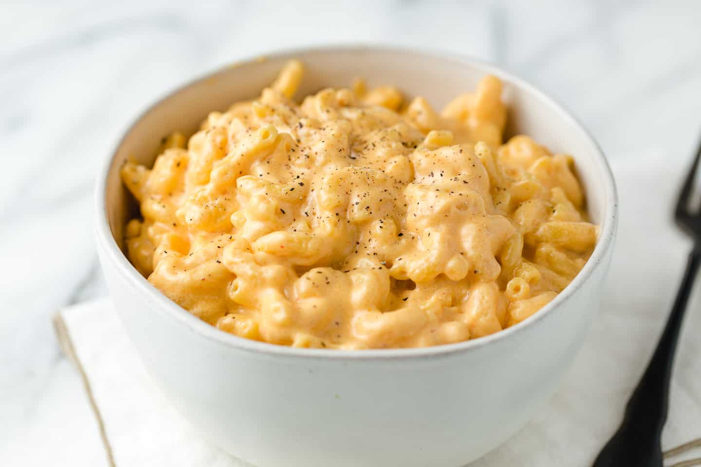 A close up view of mac and cheese in a bowl.