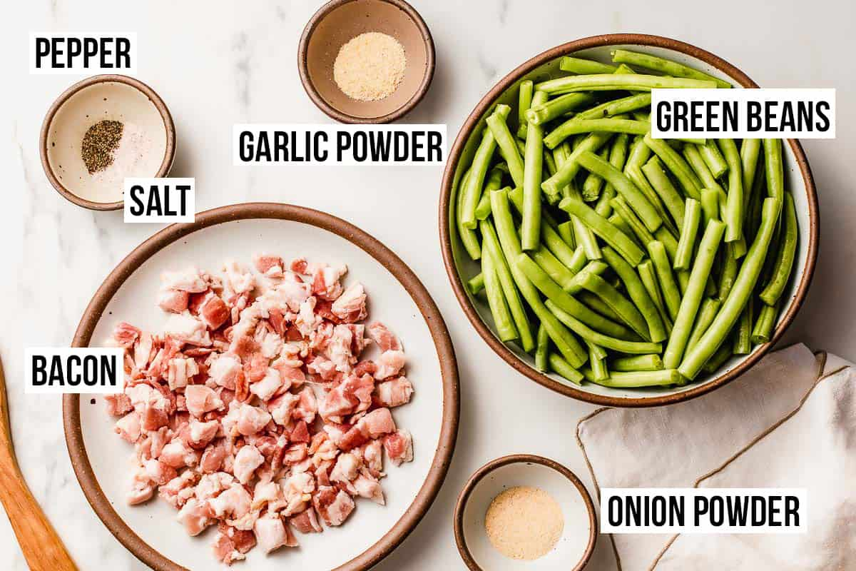 Green beans with bacon ingredients on a table.