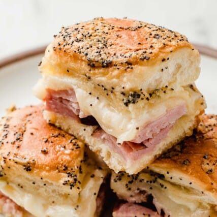 Ham and cheese sliders stacked on top of each other.