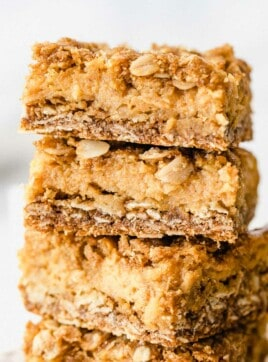 Pumpkin Pie Crumble Bars stacked on top of each other.