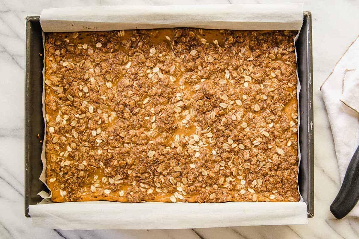 Pumpkin pie crumble bars baked in a pan.
