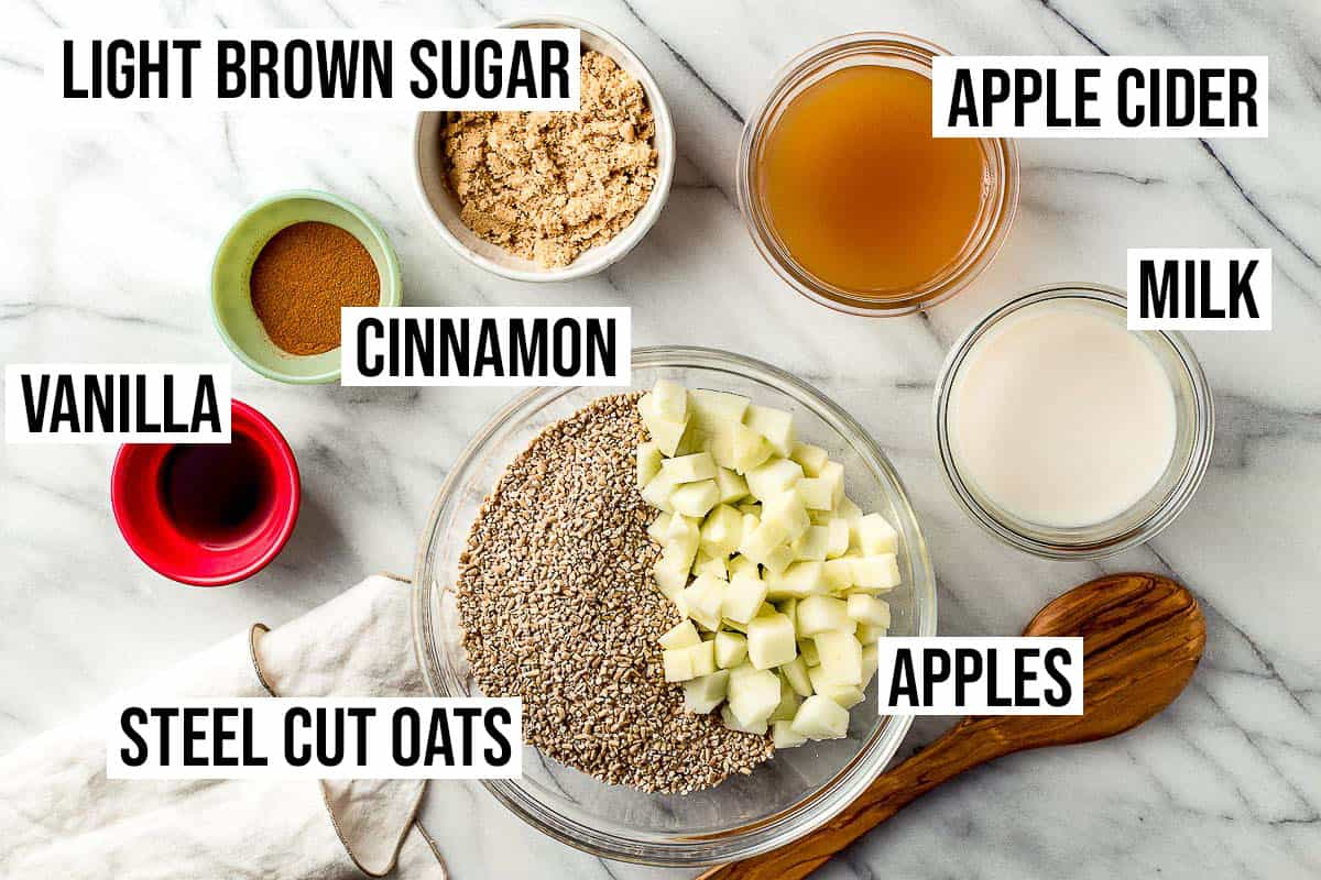 Slow cooker apple oatmeal ingredients on a table.