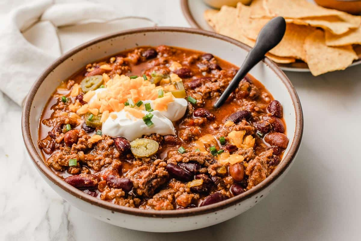 Slow cooker chili with a side of chips.
