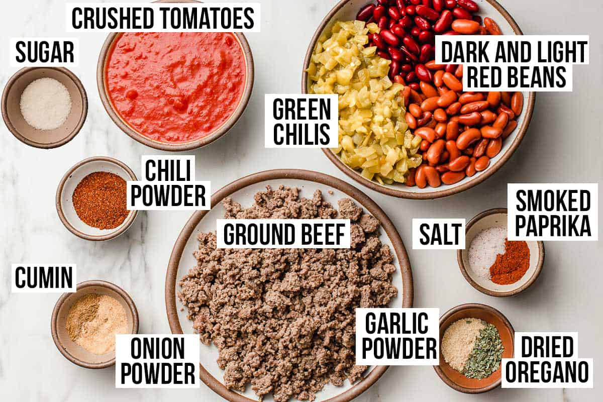 Slow cooker chili ingredients on a table.