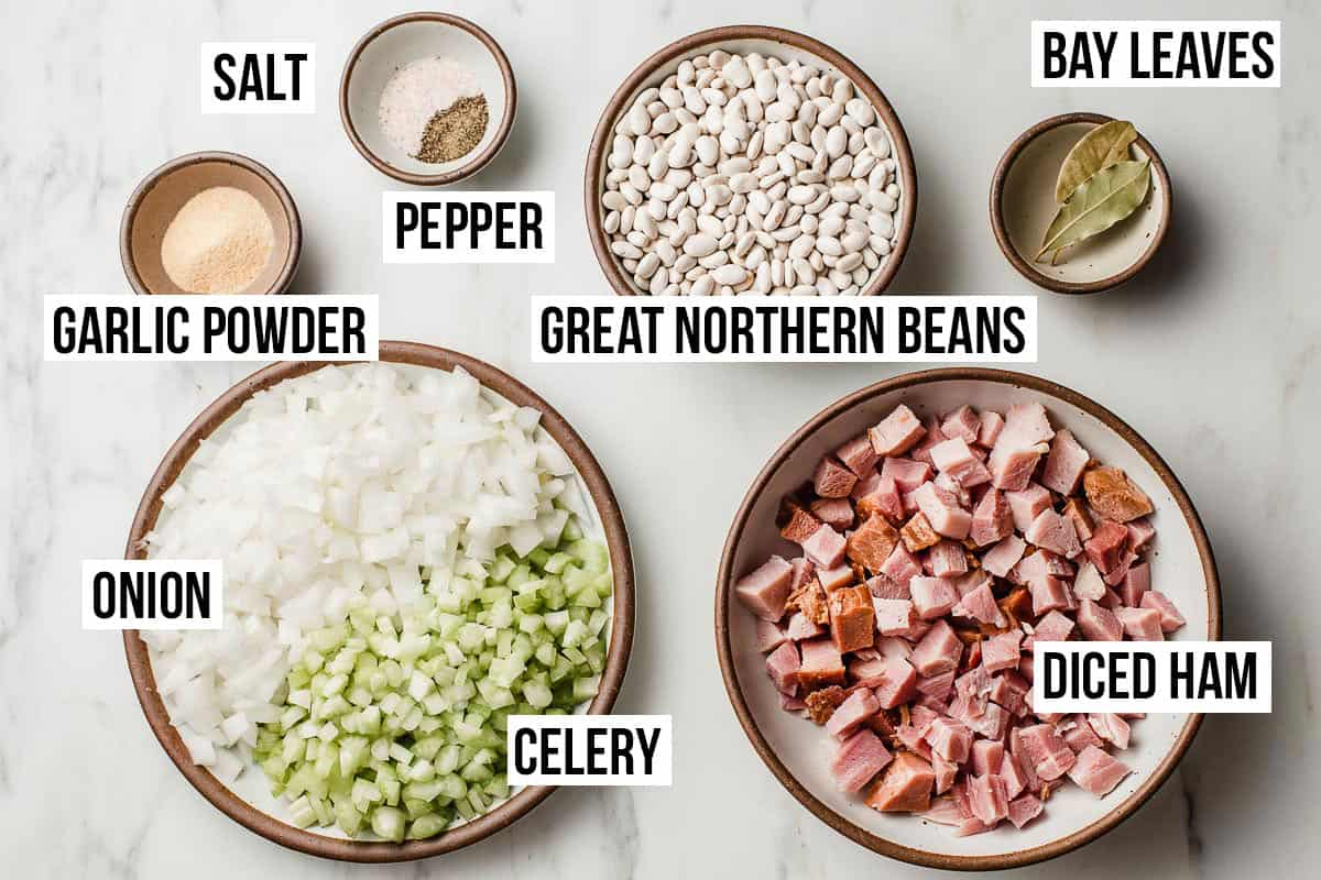 Slow cooker white beans and ham ingredients on a table.